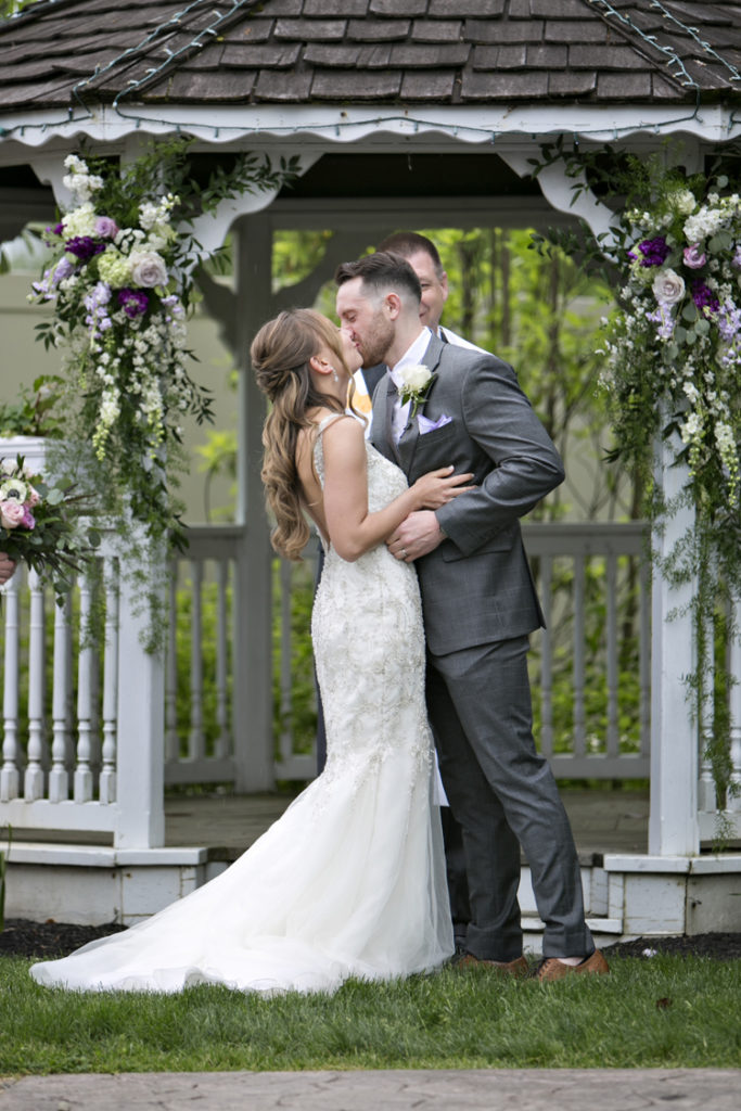 Bride and groom first kiss at the Willows in Strasburg